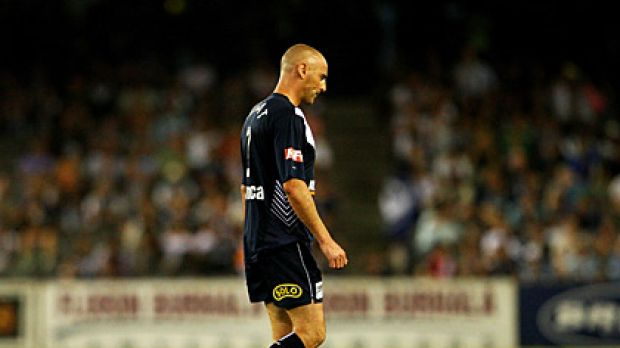 Lonely walk: Kevin Muscat leaves the field following his red card.