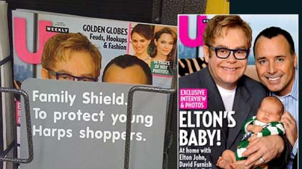 Cover up ... how the store masked the magazine cover of Elton John with partner David Furness and their baby, Zachary.