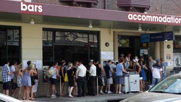 Getting personal ... patrons line up on Australia Day outside the Coogee Bay Hotel where they must agree to have their ...