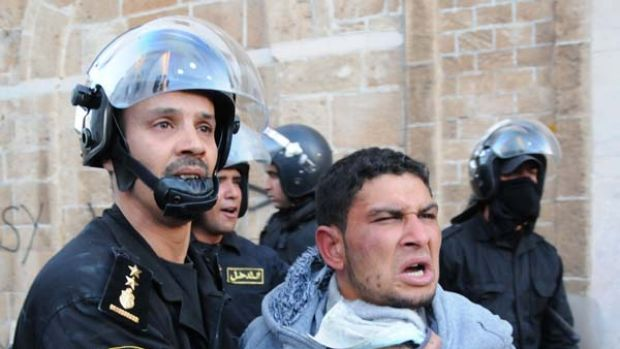 Unrest continues ... a clash in the government area of Tunis.