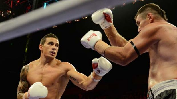 Points decision ... Sonny Bill Williams faces Scott Lewis last night at Gold Coast Convention Centre.