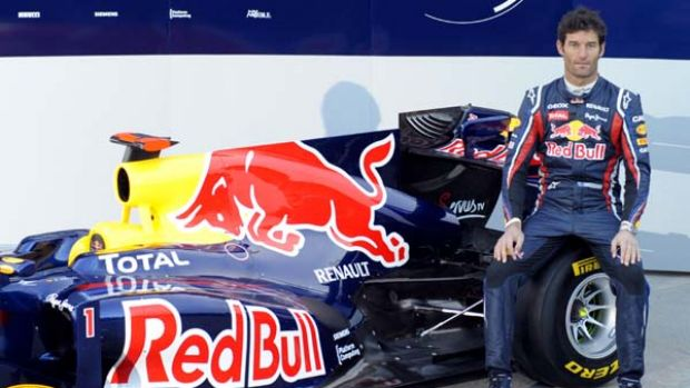 Mark Webber poses next to the new Red Bull RB7 at the Ricardo Tormo racetrack in Valencia, Spain.