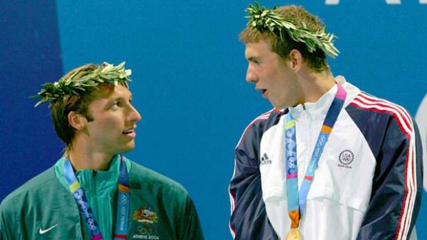 Michael Phelps of the US looks down on Ian Thorpe at the medal ceremony for the men's 4 x 200 metre freestyle relay at ...