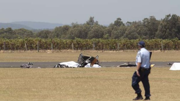 The wreckage of the helicopter that crashed and exploded in Cessnock this morning.