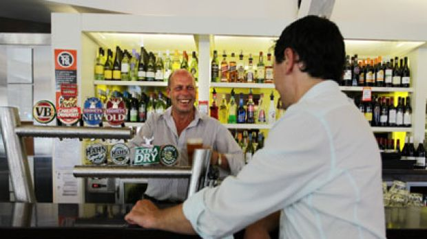 Ice cold ... Croydon Park Hotel manager Simon Elphick serves a beer to a customer.