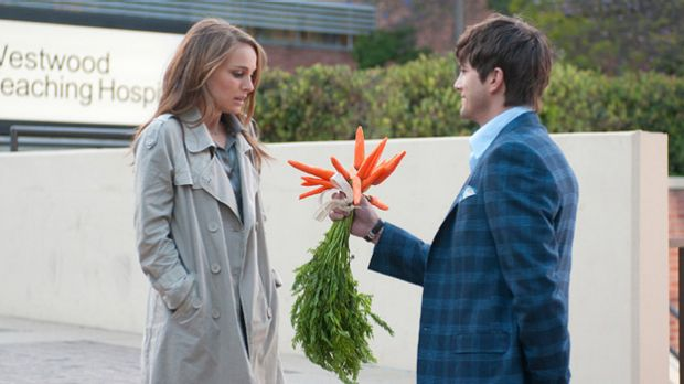 And what, exactly, am I supposed to do with these?: Natalie Portman receives a loving gesture of non-commitment from ...
