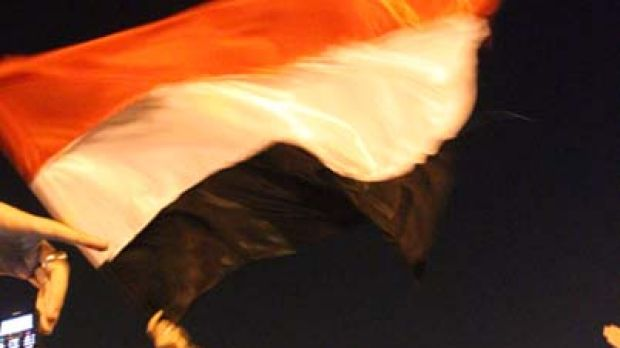 Tied the knot in Tahrir Square ... groom Abdullah al-Qadi waves a flag while being carried by a demonstrator during his ...