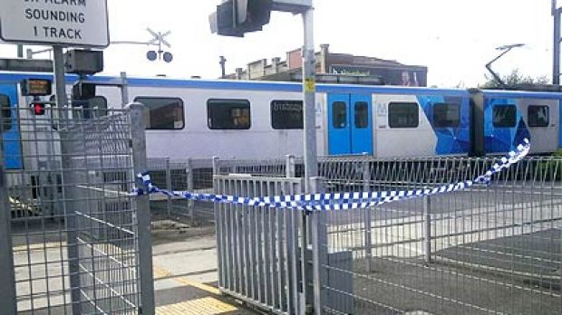 Access to the train is blocked by police tape at Bentleigh station.