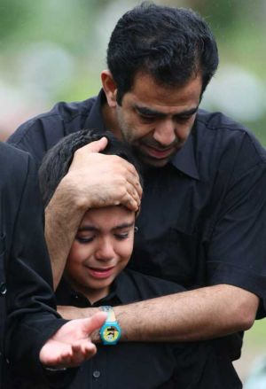 Seena, 9, grieves at the funeral for an eight-month-old baby drowned when an asylum-seeker boat broke up on rocks on ...