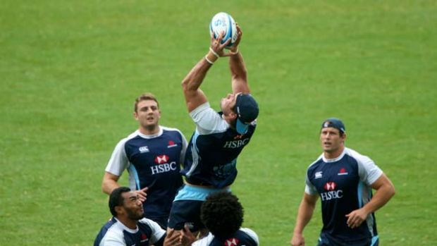 Ben Mowen takes a high ball during a Waratahs training session at the SFS yesterday.