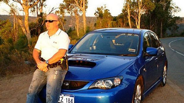 Constable Trenouth, under investigation by police internal affairs, poses in a photo taken from his Facebook page.