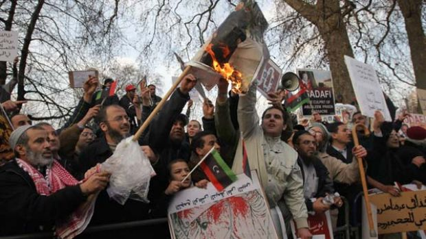 Demonstrators opposed to the regime of Libyan leader Muammar Gaddafi protest in London's Hyde Park.