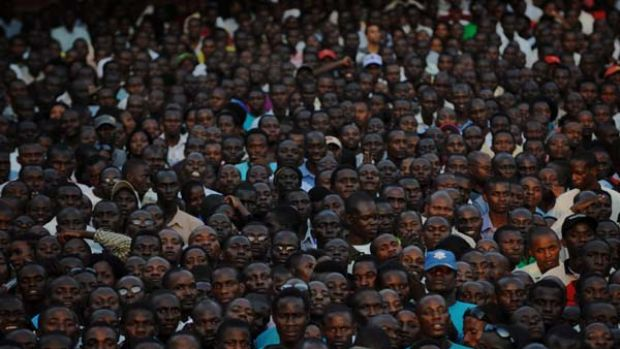 Election amid claims of homophobia ... supporters of an opposition leader, Kizza Besigye, hold a rally in Kampala on the ...