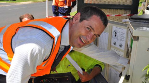 Conroy familiarises himself with the NBN at one of the installation sites in Niagara St Armidale, NSW.