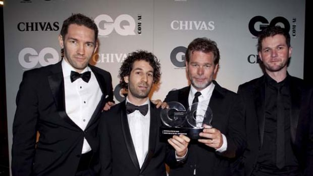 Members of the Blue Tongue Films group pose with the award for Creative Force of the Year at the 2010 GQ Men of The Year ...