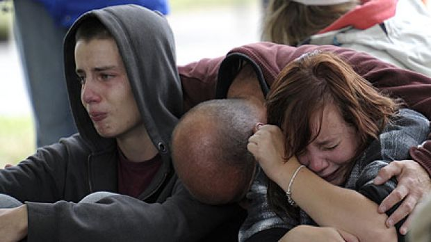 Kent Manning (left) and his sister Libby are comforted by their father after hearing there was no hope of finding their ...