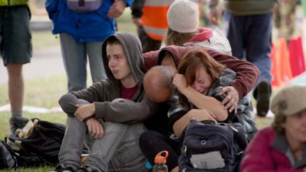 Shattered ... Jonathan Manning and his children, Kent and Lizzy, are overwhelmed  at news the search for survivors in ...