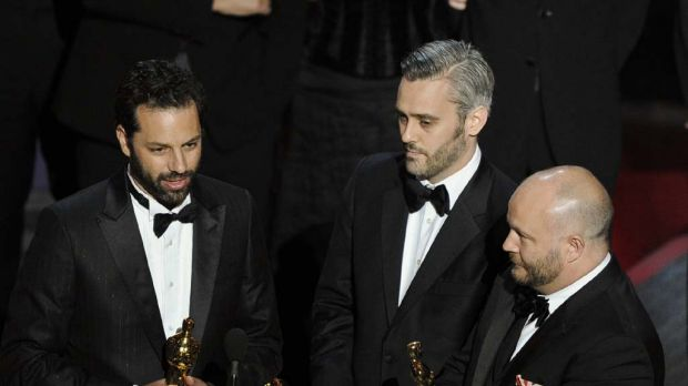 Emile Sherman, left, Iain Canning  and Gareth Unwin  accept the Oscar for best motion picture for The King's Speech.