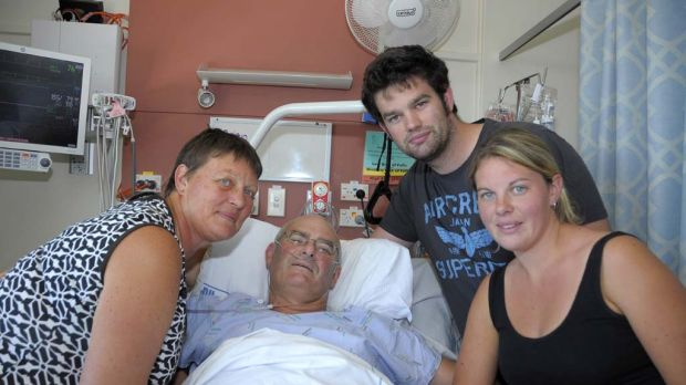 Brian Coker, who had both legs amputated in the Christchurch earthquake, in bed with his wife Helen with their children.