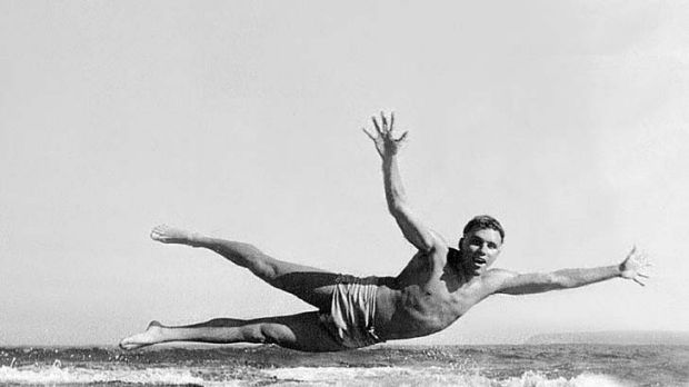 Life in the fast lane ... Grahame Wood larking about on the beach as a teenager.