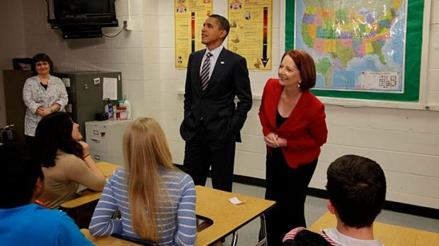 Prime Minister Julia Gillard spotted a photo of President Obama when she and Mr Obama took questions from students at ...