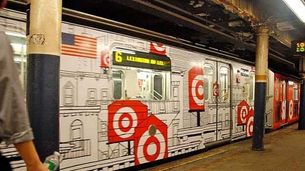 American graffiti ...  a train wrapped in advertising in New York.
