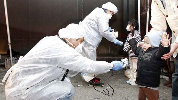 Officials check for radiation on people who lived near a nuclear plant.