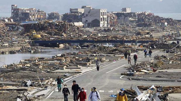 Earthquake and tsunami survivors return to what was Minamisanriku, a town of 17,000 people that has been all but wiped ...