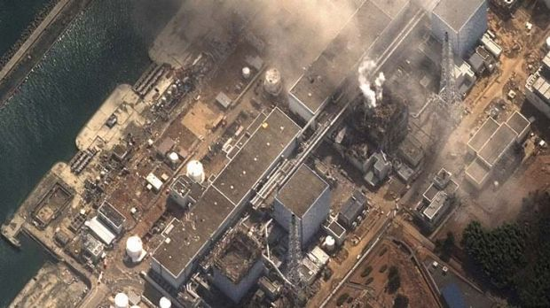 Blowing off ... fire erupts from the stricken nuclear plant at Fukushima, 250 kilometres north of Toyko.