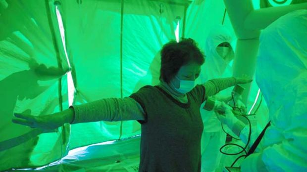 People are screened for radiation after being evacuated from the exclusion zone around the stricken Fukushima nuclear ...