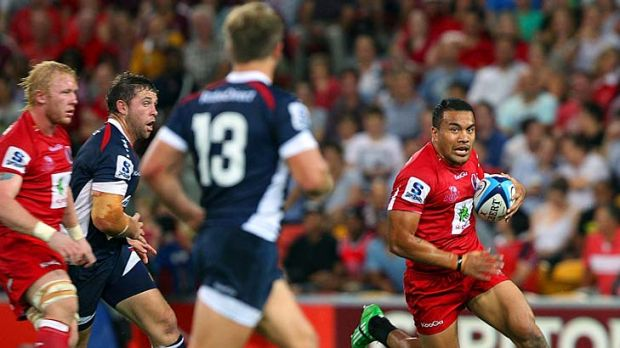 Bull at the gate . . . Digby Ioane of the Reds charges at the Rebels defenders in round five.