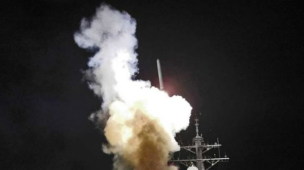 Arleigh Burke-class guided-missile destroyer USS Barry (DDG 52) launches a Tomahawk missile in support of Operation ...