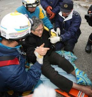 Eighty-year-old Sumi Abe is rescued from the wreckage of her home nine days after the massive 9.0 earthquake and tsunami ...