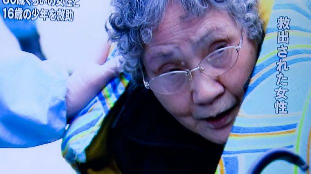TV footage ... one of the survivors, 80, who was trapped in her kitchen with her grandson. They ate food from the fridge.