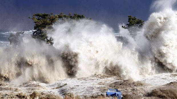 This picture taken on March 11 shows tsunami waves hitting the coast of Minamisoma in Fukushima prefecture.