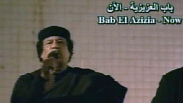 Public appearance ... Muammar Gaddafi addresses his supporters.