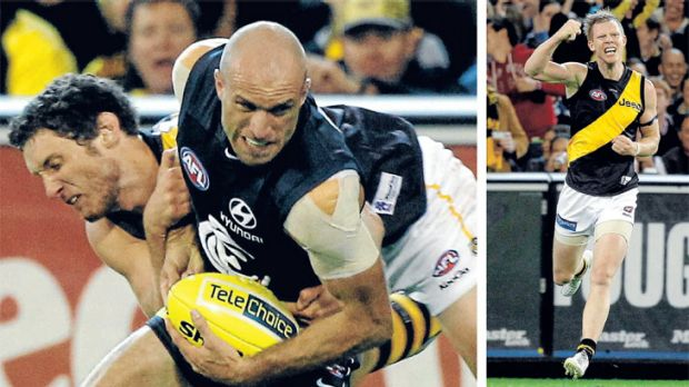 Tough tackle: Tiger's ruckman Tyrone Vickery puts the brakes on Carlton captain Chris Judd  while (right) Jack Riewoldt ...