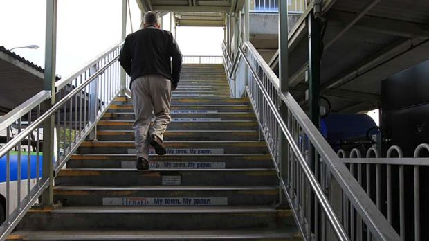 Climb every transport mountain ... Barry O'Farrell at Wyong train station, getting a taste of the transport system he ...