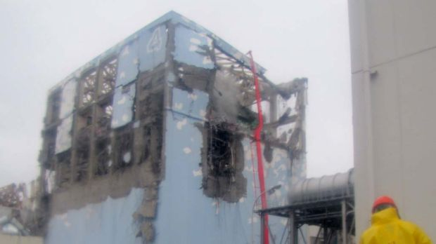 Workers in protective suits at the damaged No. 4 unit of the Fukushima Dai-ichi nuclear complex.