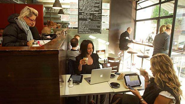 Deals with meals: Public relations consultant Natalie Frid (centre) loves doing business over coffee and a snack at a ...