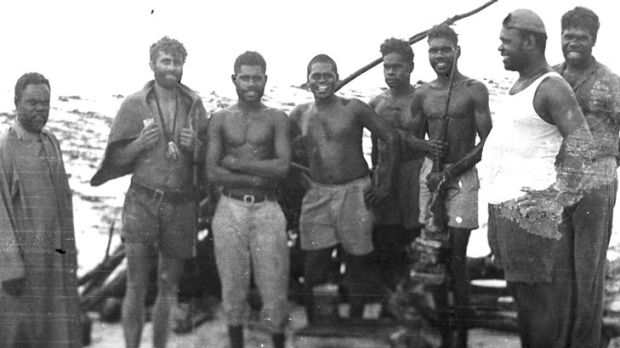 Fomenko with Aborigines who came to his aid after he tried rowing to New Guinea.
