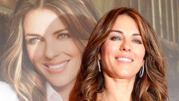 Is she, isn't she ... Elizabeth Hurley remains cagey on the subject of Shane Warne.