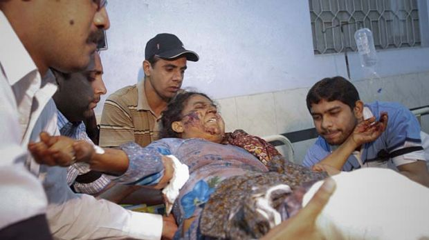 A woman injured in a suicide bomb attack at a Sufi shrine in Dera Ghazi Khan, Pakistan, is taken to a hospital in Multan.