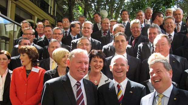 Opposition interim leader Jeff Seeney, leader-in-waiting Campbell Newman and deputy leader Tim Nicholls gather for a ...