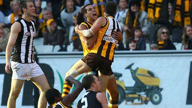 Clinton Young of the Hawks is congratulated by Lance Franklin after kicking a goal late in Hawthorn's come-from-behind ...