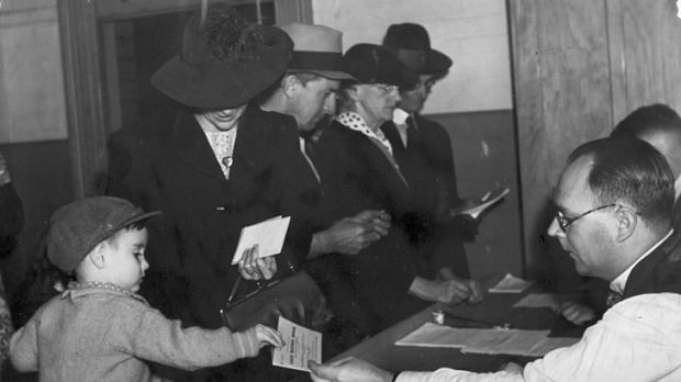 Ration books are dispensed in 1942.