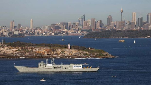 Final journey ... HMAS Adelaide was towed out of Sydney Harbour on Monday.