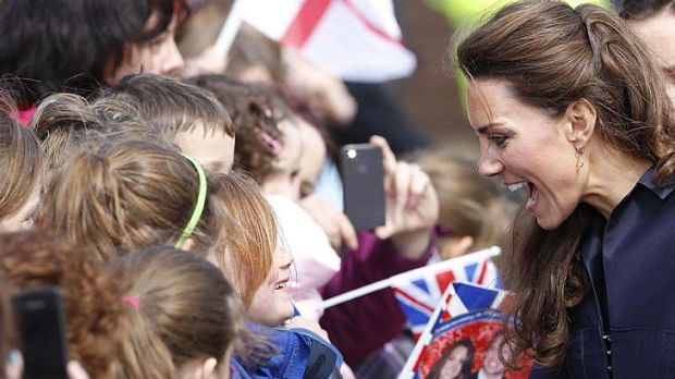 Nice to meet you .... Kate Middleton talks to some children.