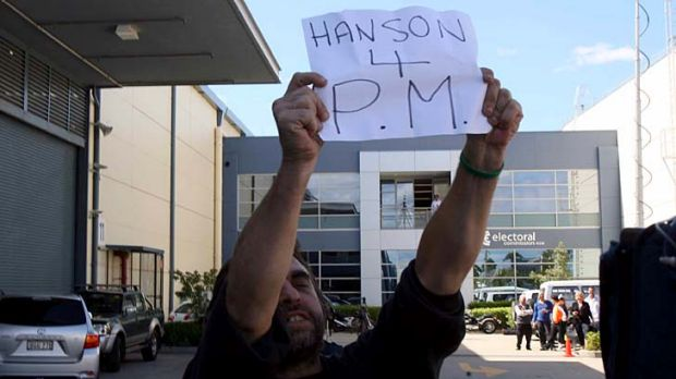 Aiming even higher ... a Hanson supporter waits for his hero.