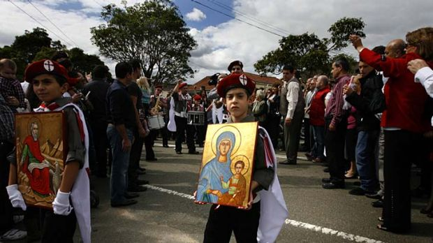 Celebration ...  young boys  from St John's Melkite Catholic Church, Greenacre, take part in the procession to mark Palm ...